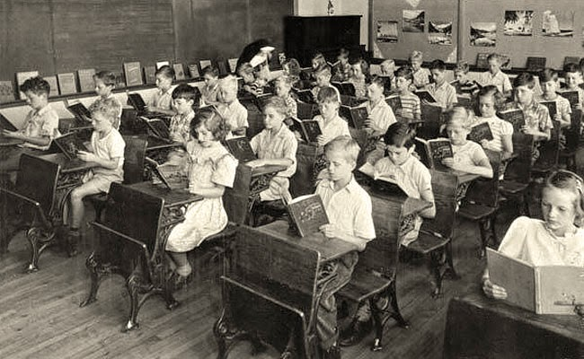 Black and white photo of old American classroom